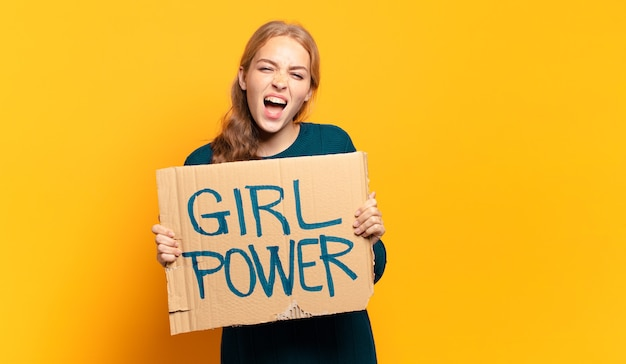 Young blonde woman. equality and girl power concept