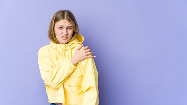 Young blonde woman having a shoulder pain.