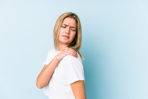Young blonde woman isolated having a shoulder pain