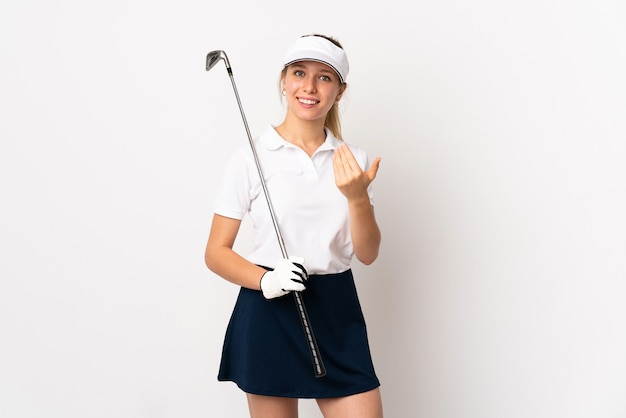 Young blonde woman isolated on white background playing golf and doing coming gesture