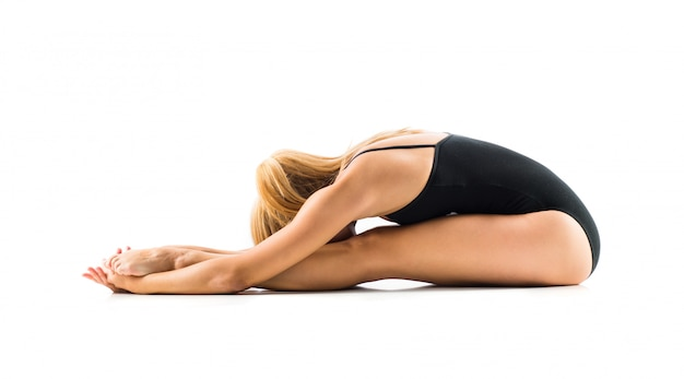 Young blonde woman in maillot practicing yoga lesson