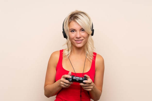 Young blonde woman playing videogames