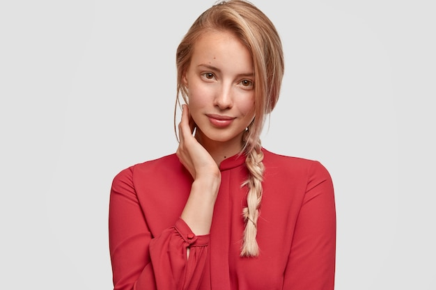 Young blonde woman in red shirt