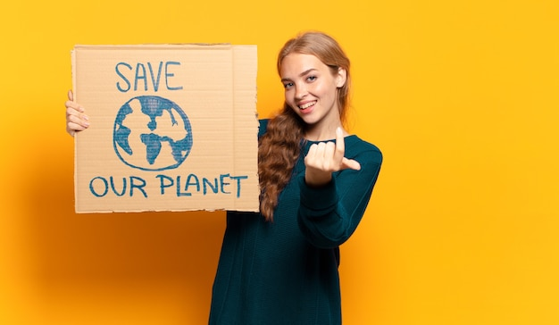 Young blonde woman. save the planet concept