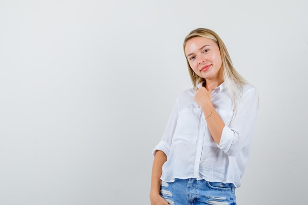 Young blonde woman in a white shirt
