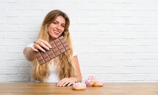 Young blonde woman with chocolat