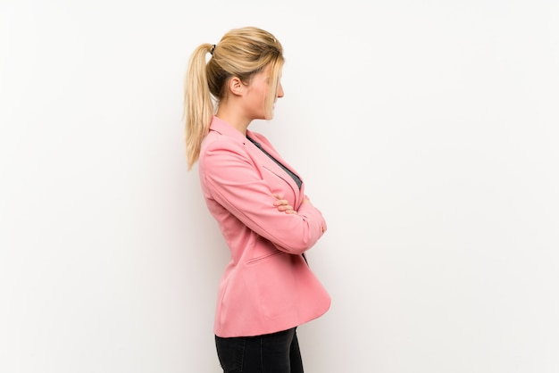 Young blonde woman with pink suit in lateral position