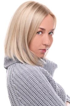 Young blonde woman with warm sweater