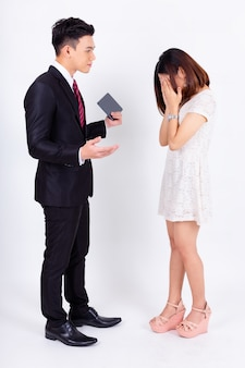 Young boss male complaining pretty secretary on white