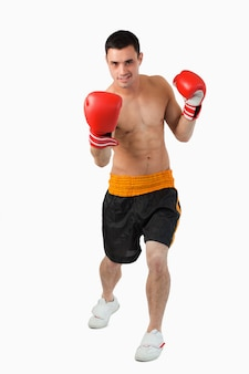 Young boxer performing uppercut