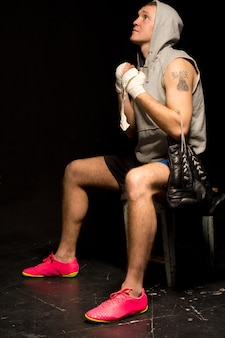 Young boxer psyching himself up before a match