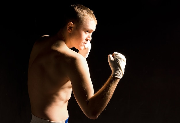 Young boxer squaring off during training