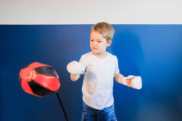Young boy boxing at home during self-isolation.