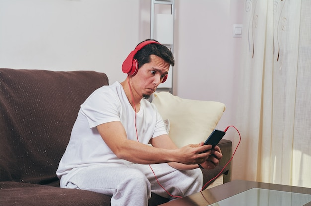 Young boy enjoys listening to music
