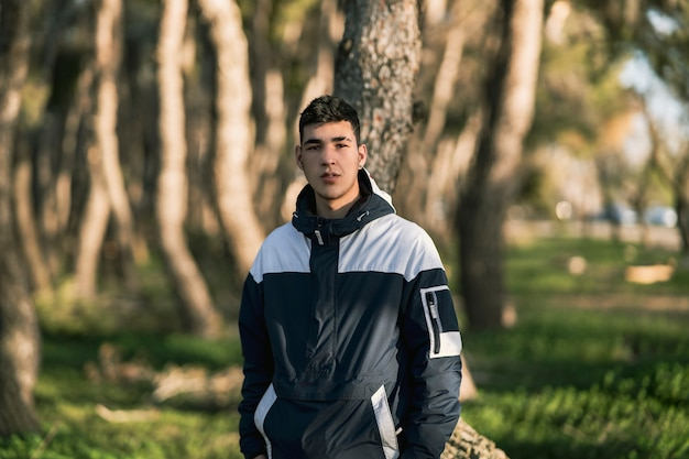 Young boy in a forest with sportswear