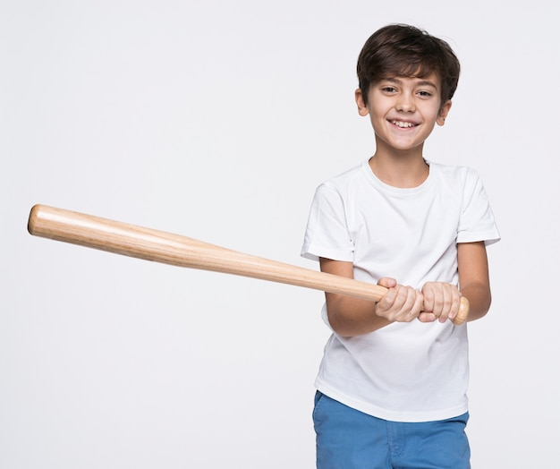 Young boy hitting with baseball bat