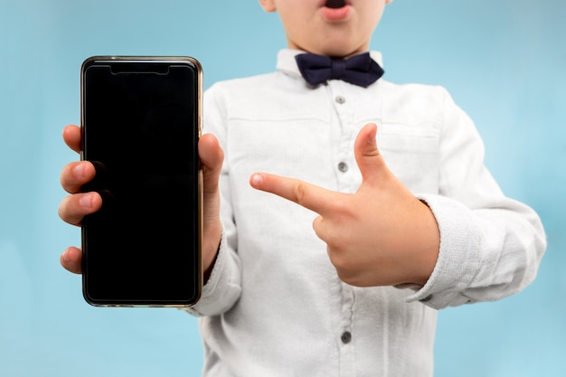 Young boy holding blank smartphone