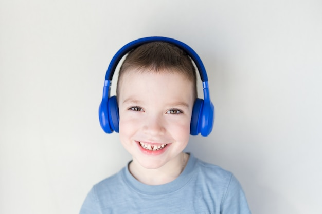 Young boy is smiling and listening to music