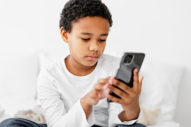 Young boy kid using mobile