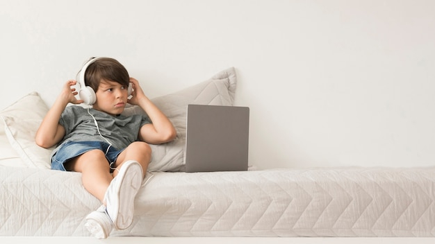 Young boy looking on laptop