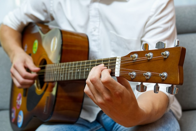 Young boy playing guitar.