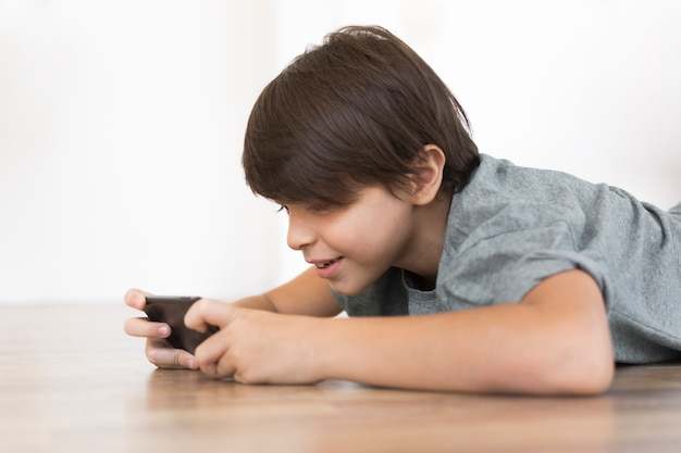 Young boy playing on smartphone
