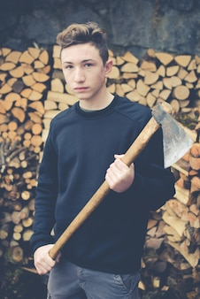 Young boy prepares firewood