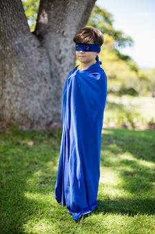 Young boy pretending to be a superhero