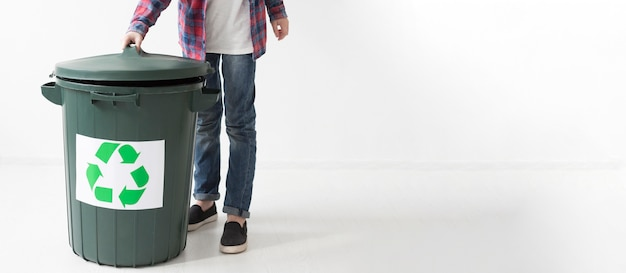 Young boy and recycle bin with copy space
