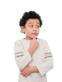 A young boy thinking on white background