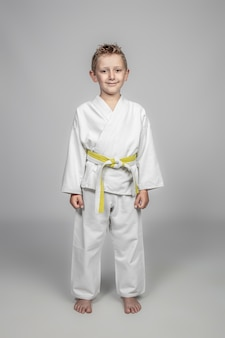 Young boy wearing martial arts costume
