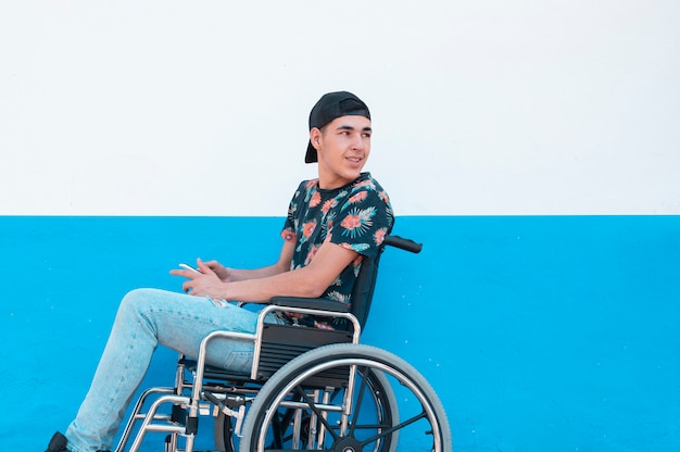 Young boy in a wheelchair with mobile