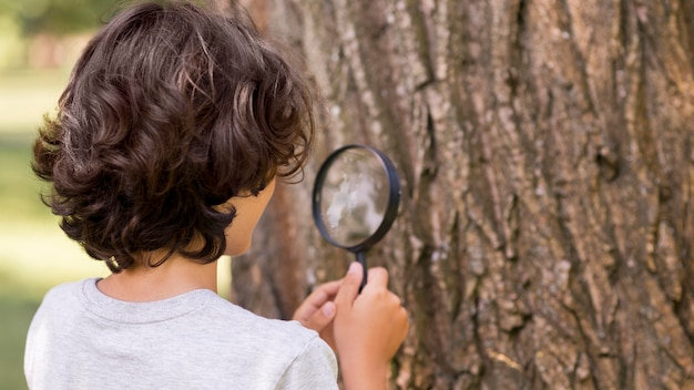 Young boy with magnifier
