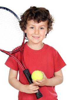 Young boy with tennis racket and ball