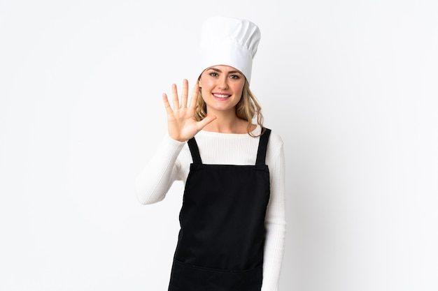Young brazilian chef woman isolated on white counting five with fingers