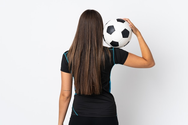 Young brazilian woman isolated on white background with soccer ball