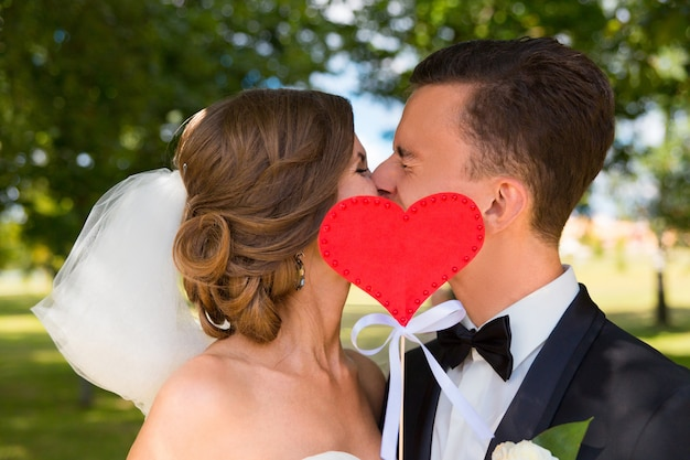 Young bride and groom kissing