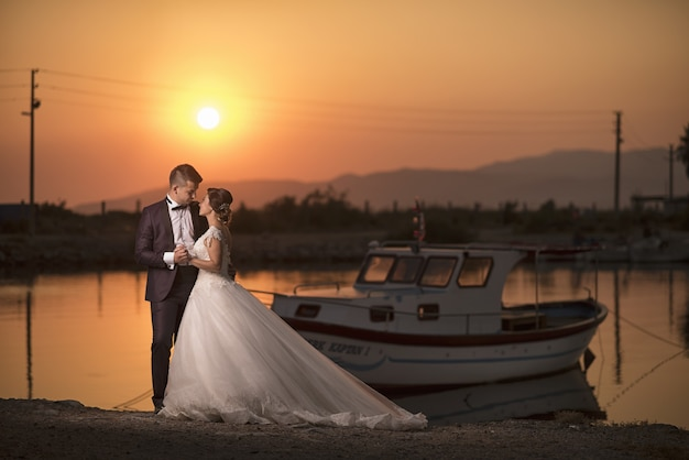 Young  bride and groom outdoor photoshoot