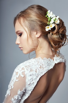 Young bride in a luxurious white wedding dress