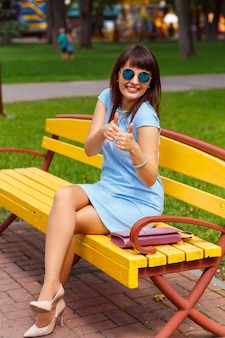 A young brown haired woman in blue dress