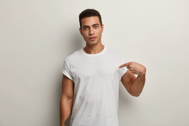 Young brunet man wearing white t-shirt