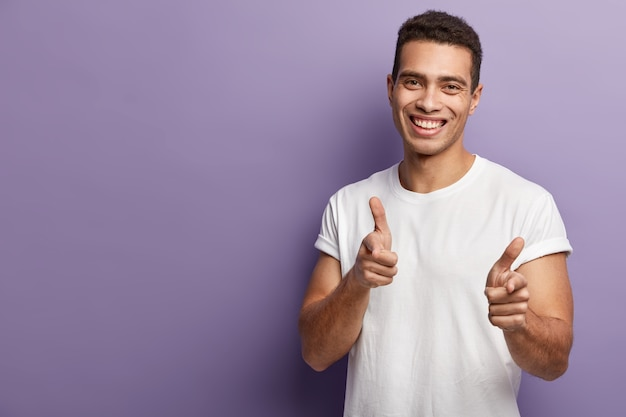 Young brunet man wearing white t-shirt