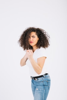 Young brunette in fighting pose