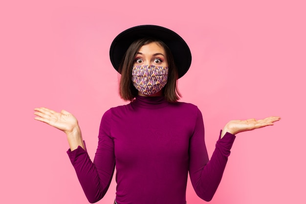 Young brunette girl wearing respiratory face mask against coronavirus.