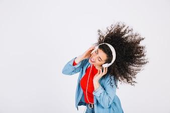 Young brunette in headphones shaking hair