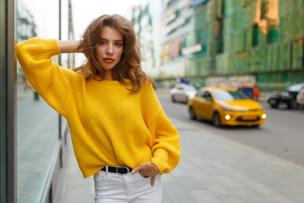 Young brunette model holding her hand in the pocket