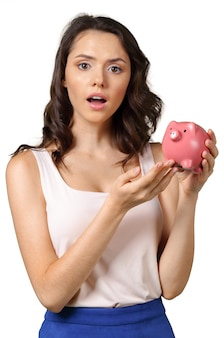 Young brunette with piggy bank.