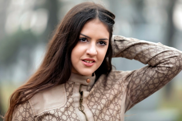 Young brunette woman posing in the city