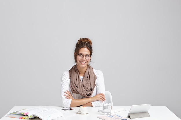 Young brunette woman sitting at desk