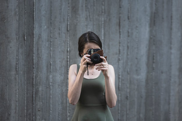 Young brunette woman taking a photo